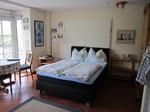Haus Käptn Jensen, Insel Amrum Wohnung Doppelbett